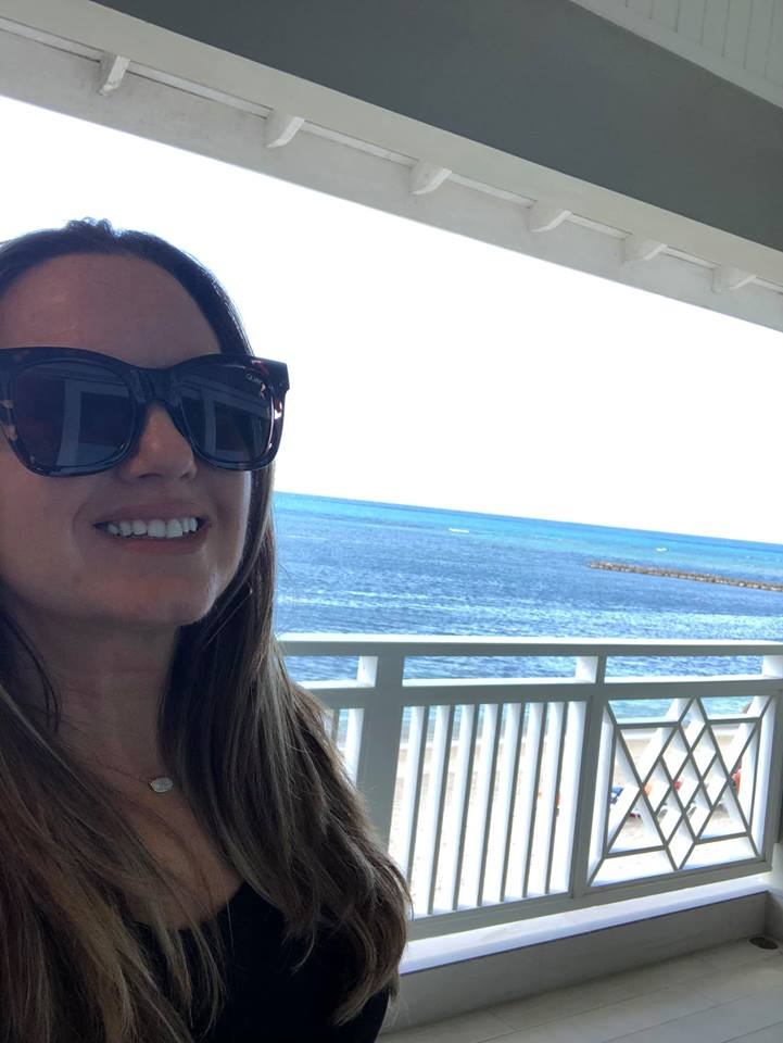 Woman taking selfie with water in background at Sunscape Splash Resort in Montego Bay.| Montego Bay, Jamaica; Sunscape Splash Resort