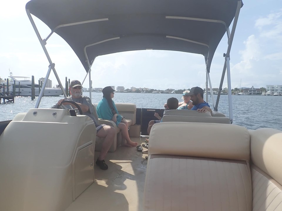 People riding a pontoon from Sunshine Rentals in Destin.   Destin, Florida with the Kids