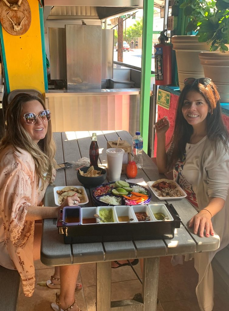Two women eating tacos at Guss in Cabo. | A Guide to Nobu Hotel Los Cabos - A Relaxing Girls Trip