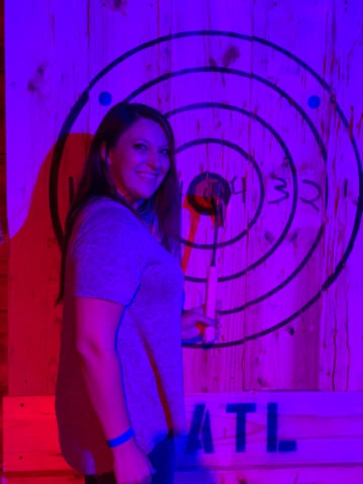 Women practicing axe throwing at Texas Axe Throwing   Girls Weekend Getaway- Woodlands, TX