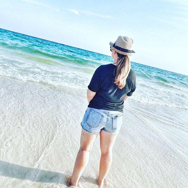 Woman standing on the beach on Emerald Coast beach in Destin.   Destin, Florida with the Kids