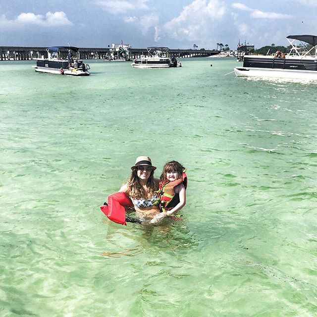 Woman in the water with her daughter in Destin.   Destin, Florida with the Kids