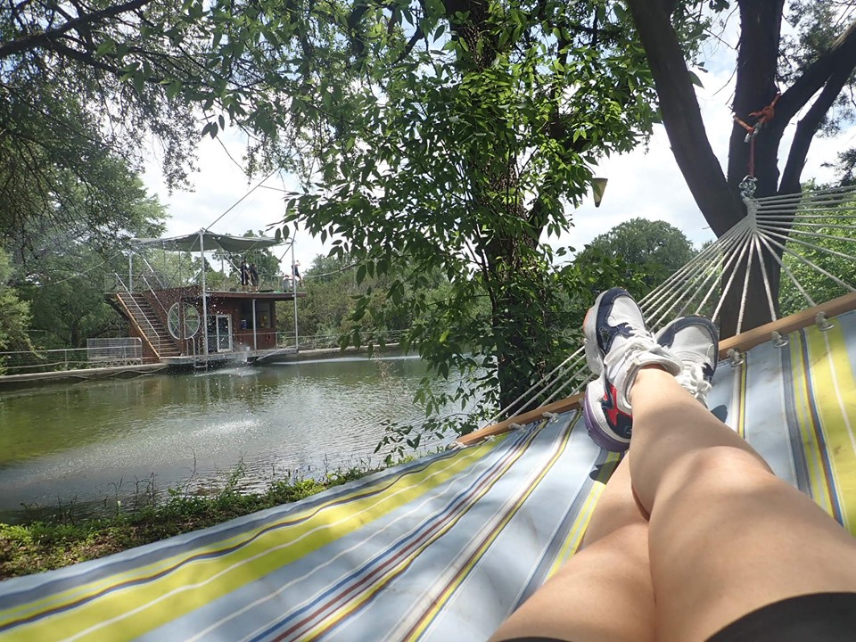 Woman sitting in a hammock at Cypress Valley. | Cypress Valley Canopy Tour in Austin, Texas