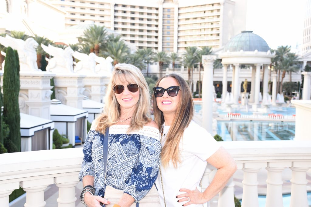 Women posing in front of Caesars Palace. | Las Vegas- A Guide to Vegas