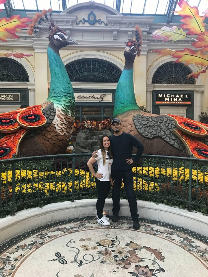 Couple posing in front of Vegas Hotel.| Las Vegas- A Guide to Vegas