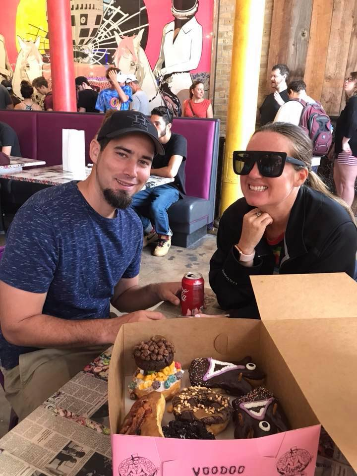 Couple enjoying a box of donuts at Voodoo Donuts in Austin.  Weekend Guide to Austin, Texas