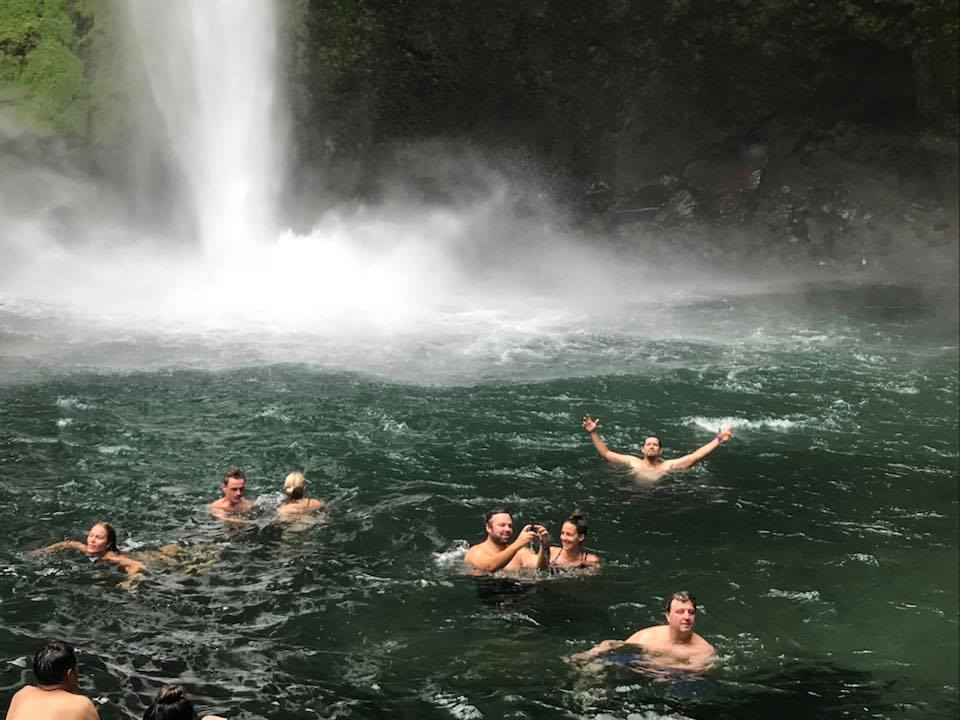 Group of people swimming at La Fortuna Waterfall in Costa Rica.   Costa Rica, Arenal Volcano