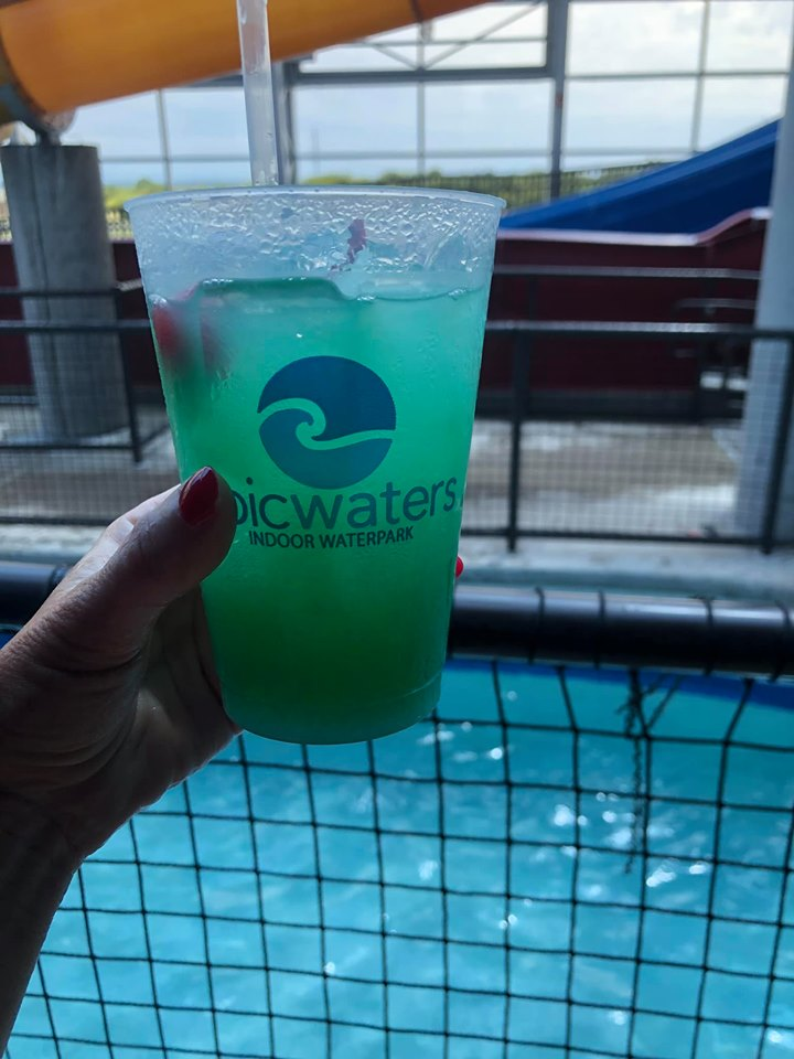 Woman holding cocktail drink at epicwaters at Epic.| Epic Waterpark in Dallas, Texas