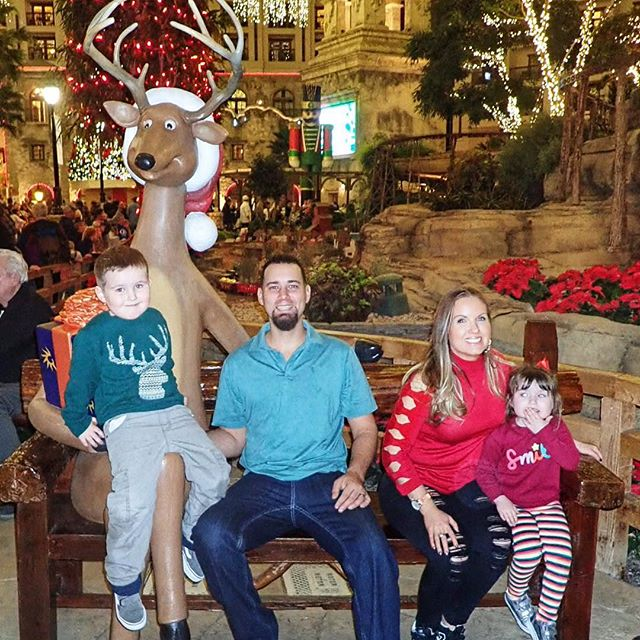 Family posing with reindeer at the Gaylord Texan in Texas. | Christmas at the Gaylord Texan Hotel