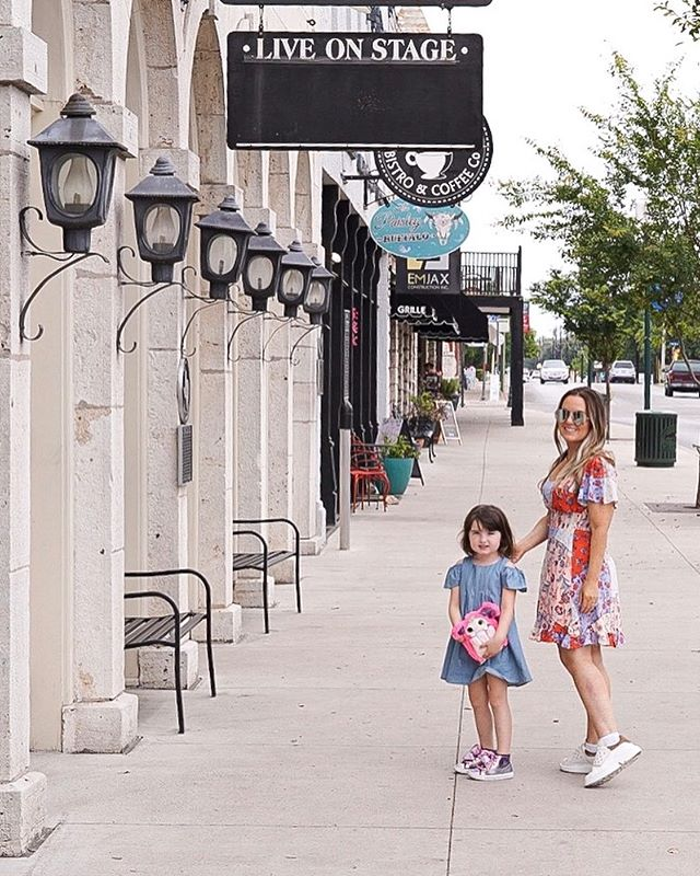 Woman and little girl outside enjoying a beautiful day at the charming Historic Granbury Square.  A Guide to Granbury, Texas