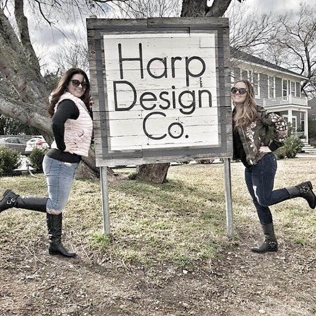 Two women posing in front of Harp Design Co sign in Waco. | Waco, TX; Birthday Weekend in Magnolia