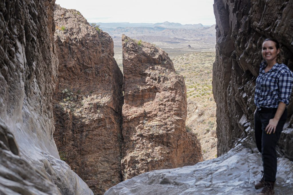 Woman posing with window trail and large rocks at Big Bend.   Best Places to Travel in 2021