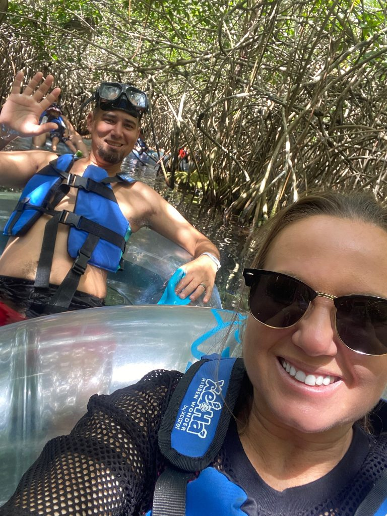 Man and woman taking a selfie tubing through the jungle waters at Xei Ha| All About XeI-Ha Park in Riviera Maya