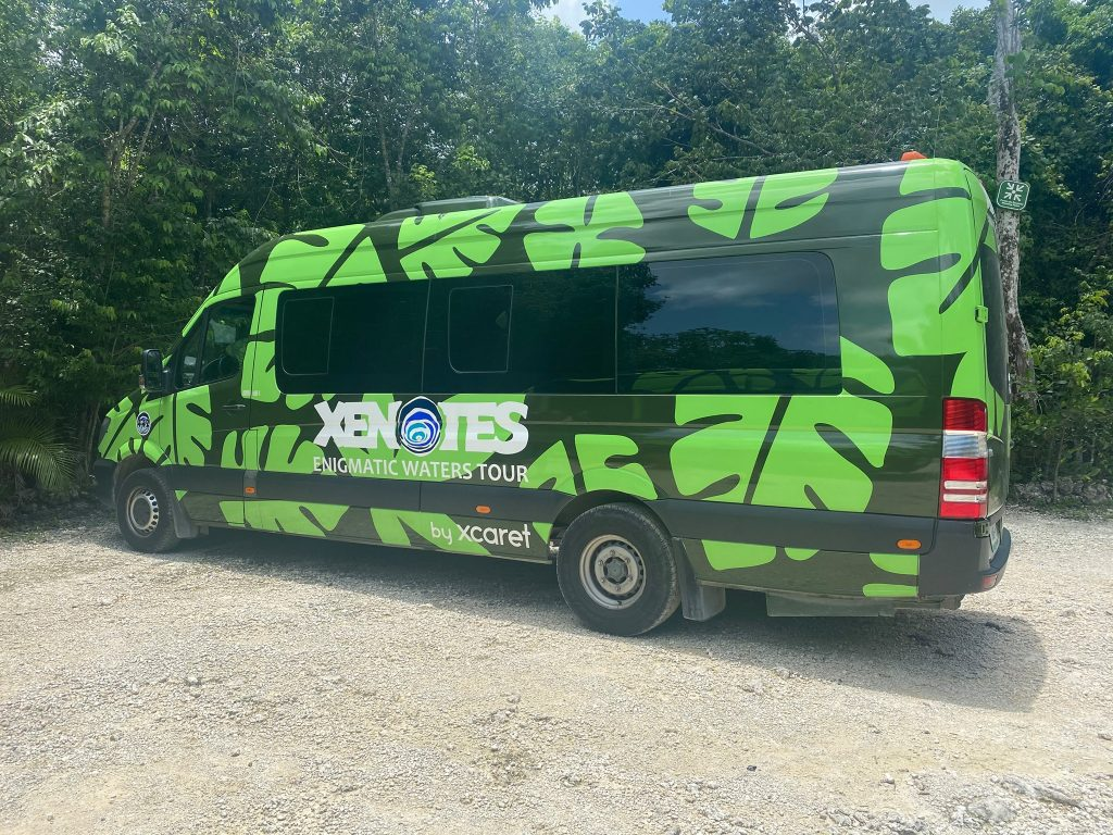 Xenotes green tour bus.   A Guide to Xenotes Water Tours by Xcaret