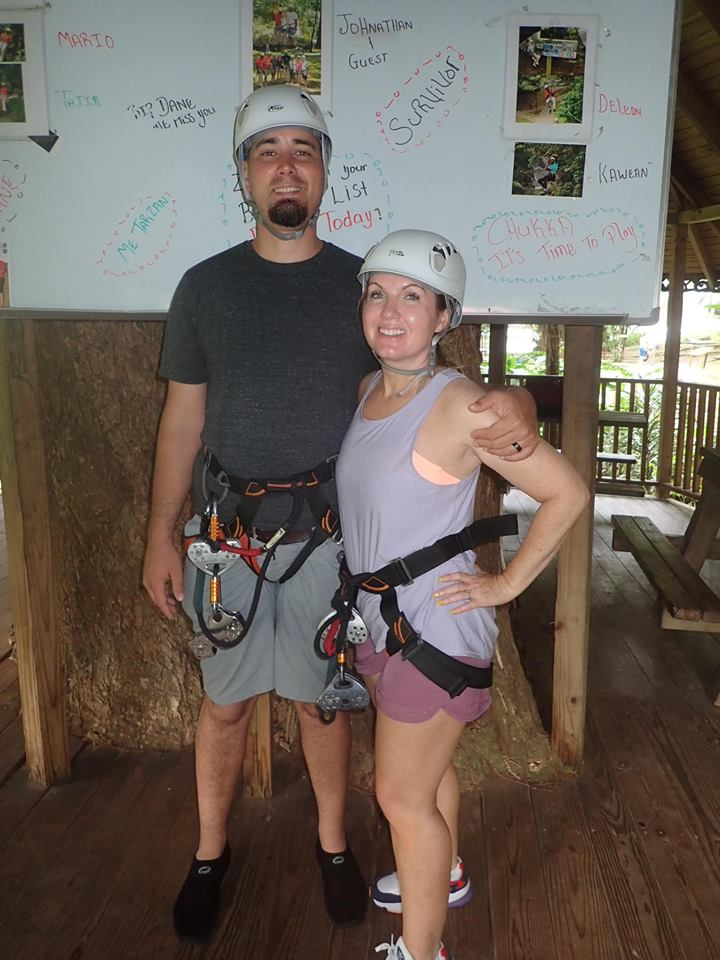 Couple posing with zip lining gear on at YS Falls Excursion in Jamaica.   Jamaica Over-Water-Bungalows