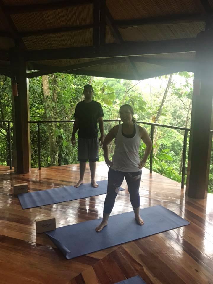 Couple doing yoga at the resort in Costa Rica.   Costa Rica, Arenal Volcano