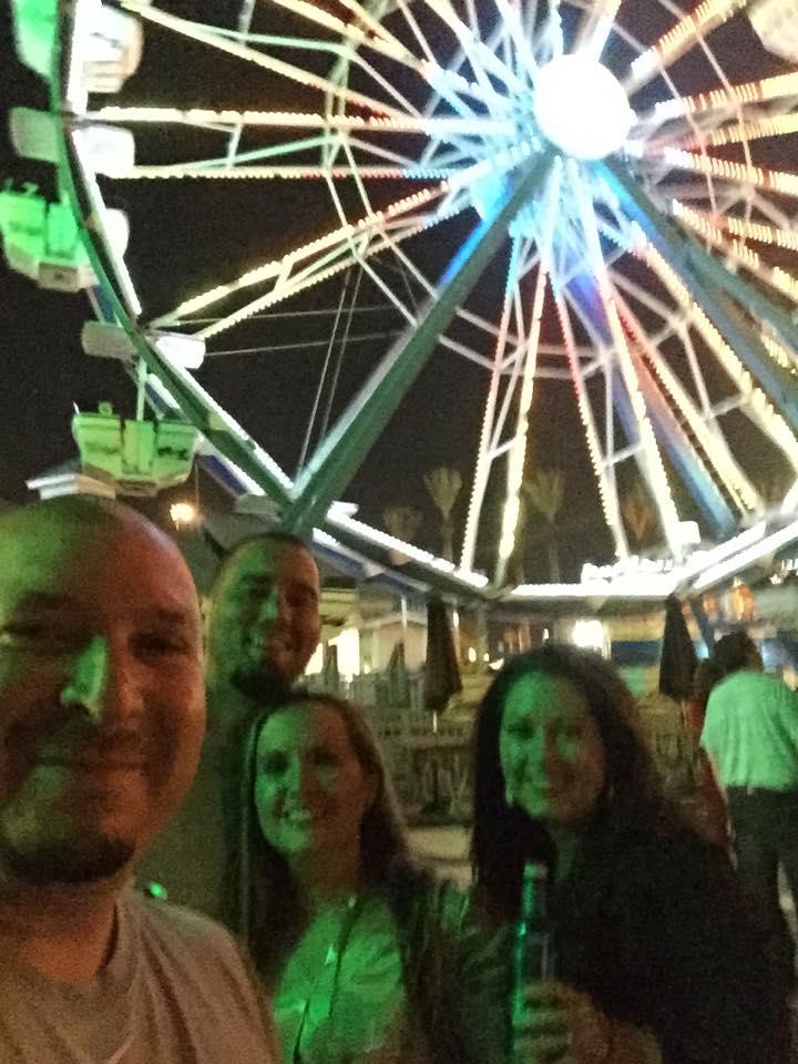 Friends at the boardwalk at night at Kemah Boardwalk. | Kemah Boardwalk in Texas