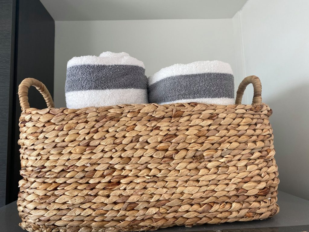 Wicker basket with beach towels rolled up inside.| Lively Beach in Corpus Christi, Texas
