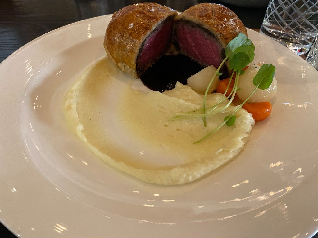Plate of beef wellington with mashed potatoes.     Where to eat in Las Vegas