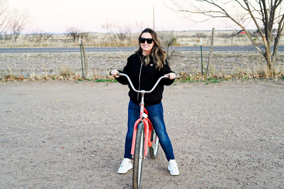 Woman riding a bike in Marfa. | Marfa, Texas- Where to Stay, What to do, & What to Eat