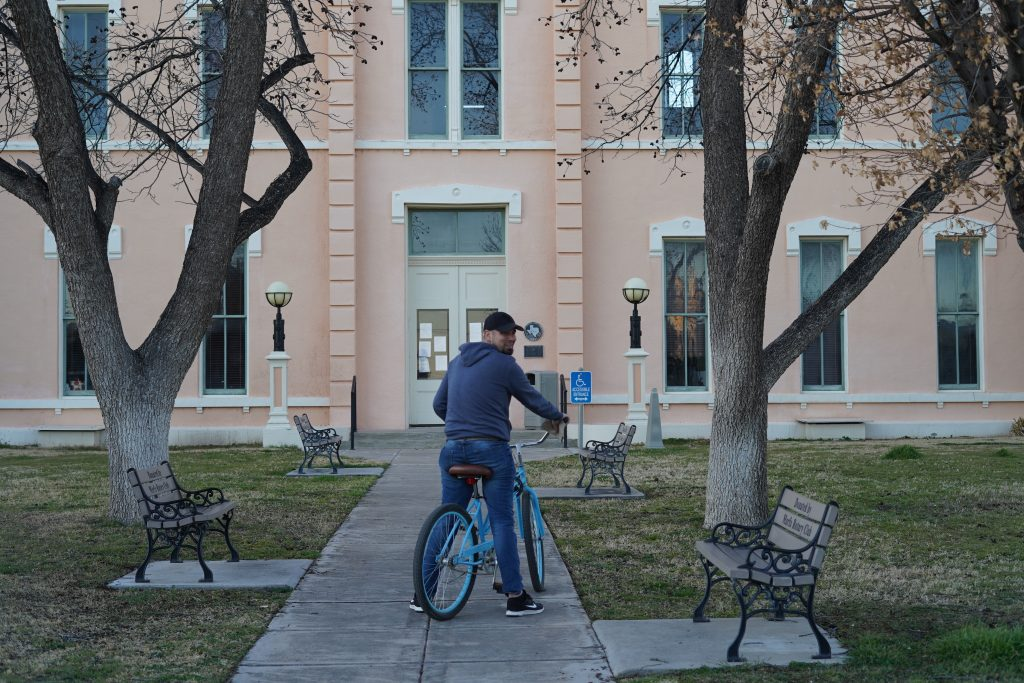 Man biking around El Cosmico in Marfa. | Marfa, Texas- Where to Stay, What to do, & What to Eat