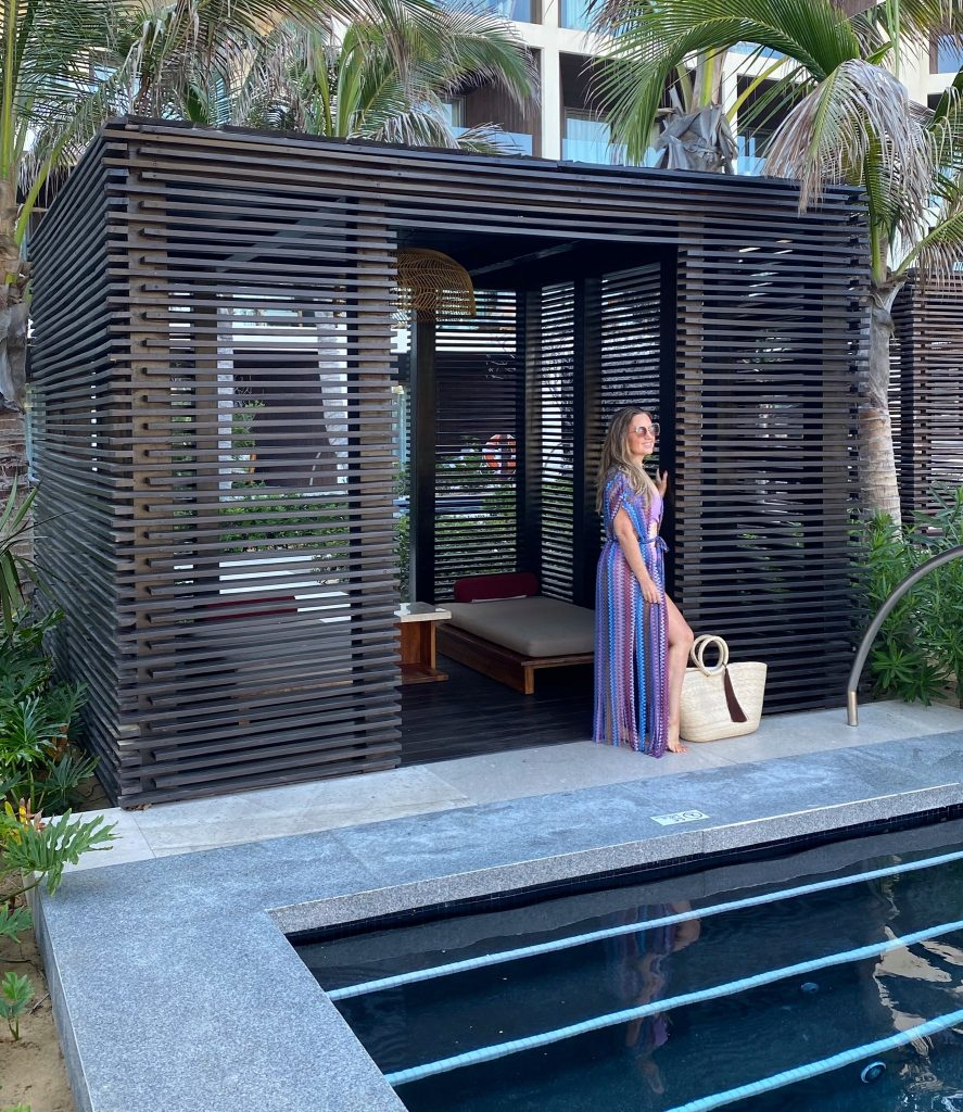 Woman posing in front of pool cabana. | A Guide to Nobu Hotel Los Cabos - A Relaxing Girls Trip