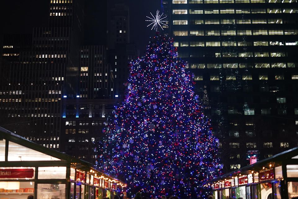 Christmas tree lit up at night at Bryant Park.  New York City