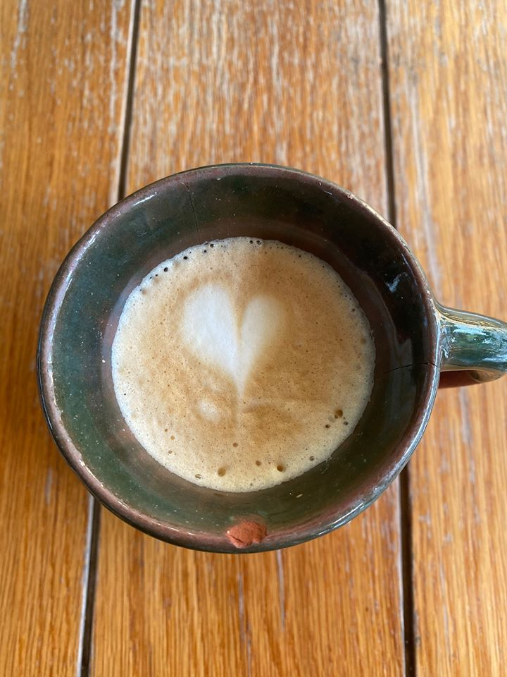 Cup of coffee with a foam heart.   Guide to Hotel Xcaret in Mexico