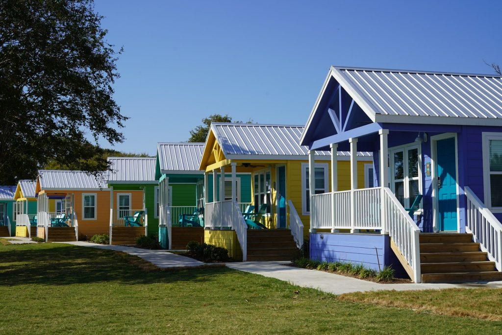 Colorful cottages at Lake Conroe. | Margaritaville Lake Resort, Lake Conroe