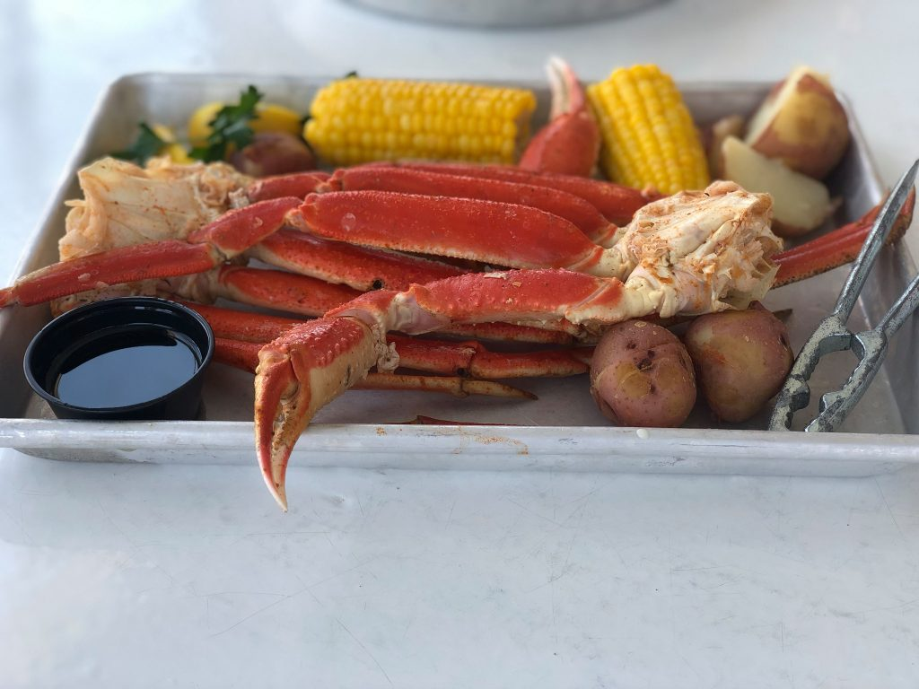 Platter of crab legs at The Hang Out restaurant.   Guide to Gulf Shores & Orange Beach Alabama