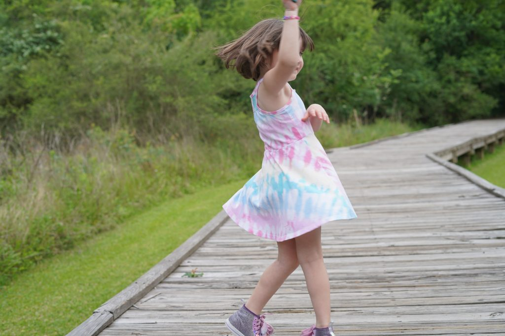 Little girl dancing on a path at the nature park in League City. | 6 Things for Families to do at a Nature and Wildlife Park