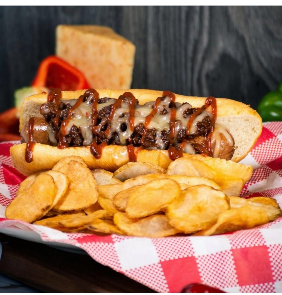 Plate of a diablo hotdog with chips at Six Flags.   Guide to Six Flags over Texas Hallowfest