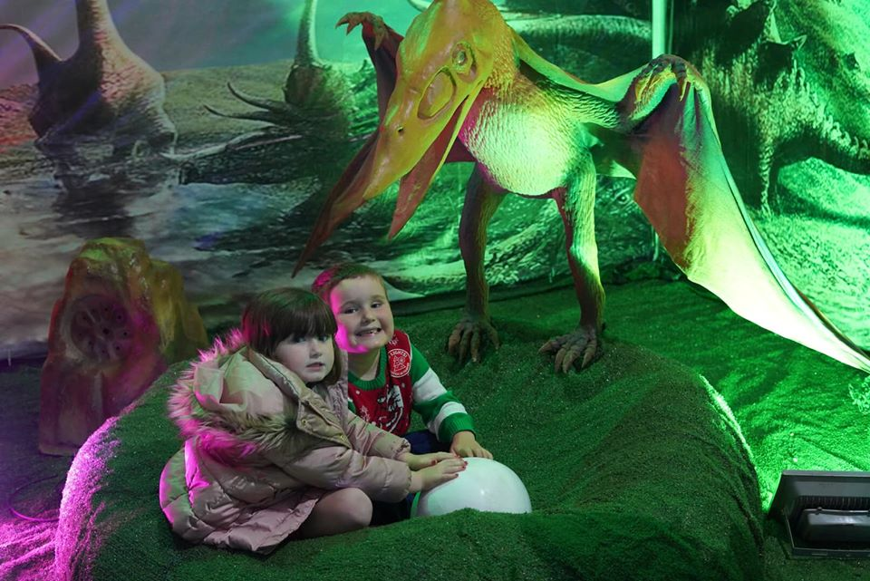 Kids playing in the dino play area. | Magical Winter Lights Houston