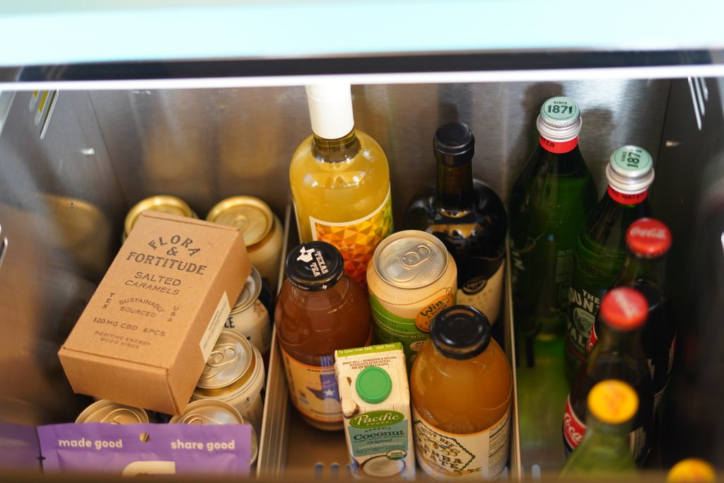 Mini fridge filled with snacks at El Cosmico in Marfa. | Marfa, Texas- Where to Stay, What to do, & What to Eat