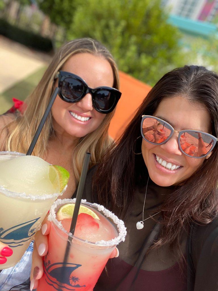 Two women taking a selfie holding margaritas. | Margaritaville Lake Resort, Lake Conroe