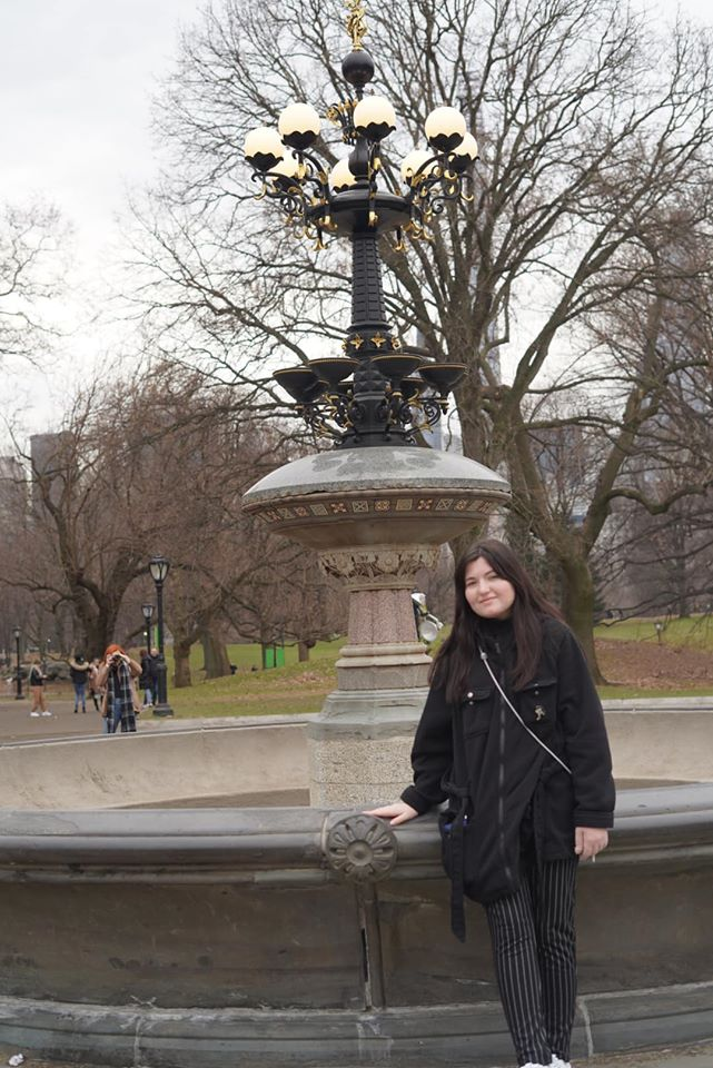 Girl posing in front of Friends fountain at  Central Park.   New York City