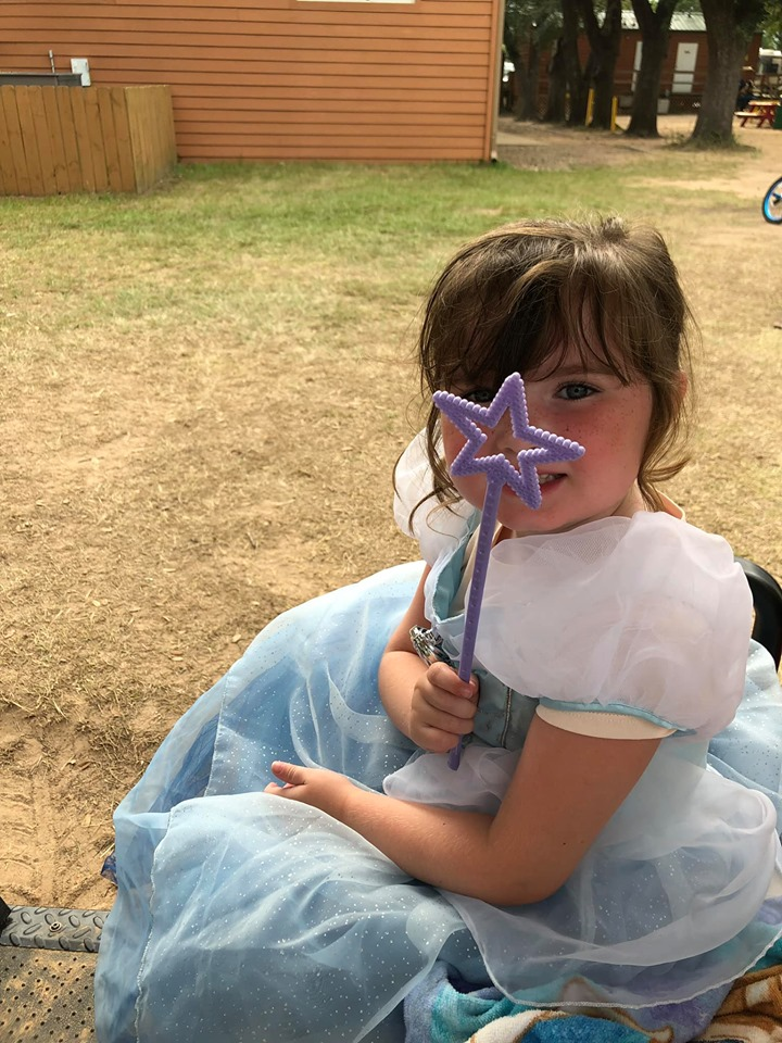 Little girl showing her star wand gift at Jellystone in Texas.   Jellystone Park in Waller, Texas