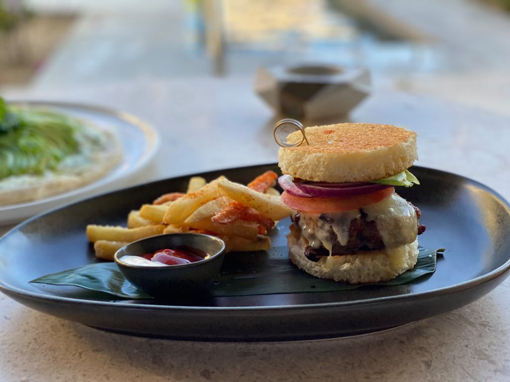 Hamburger and fries at restaurant.| A Guide to Nobu Hotel Los Cabos - A Relaxing Girls Trip