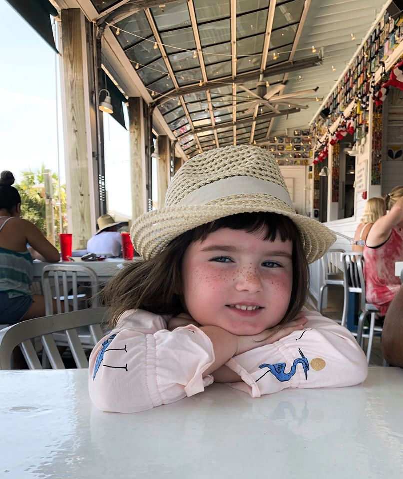 Little girl smiling for the camera at a restaurant.  Guide to Gulf Shores & Orange Beach Alabama