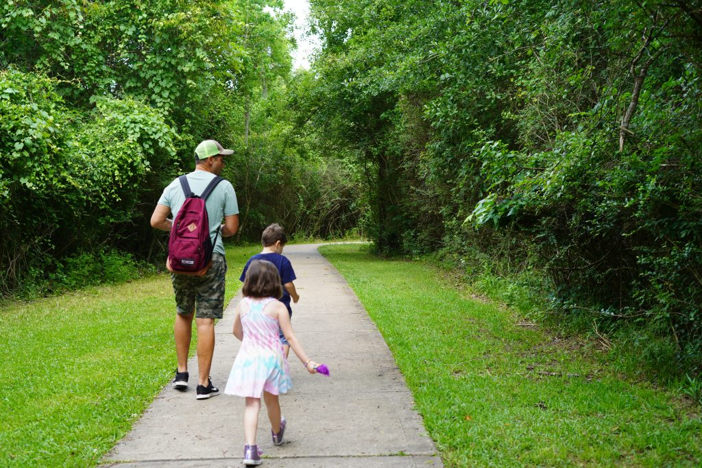 Family walking on a path at the nature park in League City. | 6 Things for Families to do at a Nature and Wildlife Park