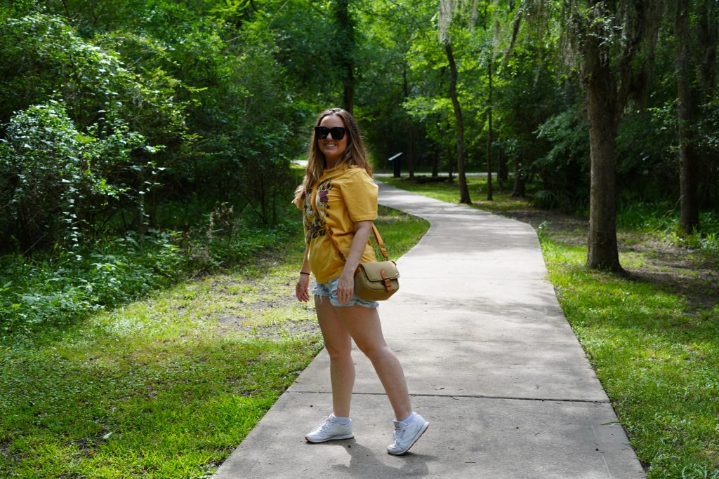 Woman walking on a path at the nature park in League City. | 6 Things for Families to do at a Nature and Wildlife Park