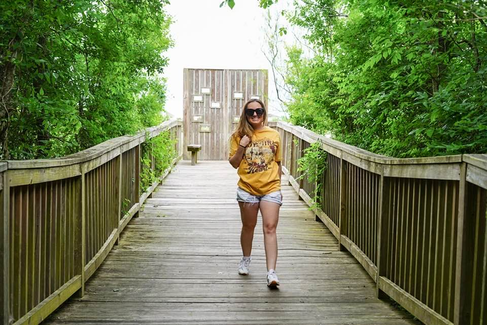 Woman walking on boardwalk nature trail. | 6 Things for Families to do at a Nature and Wildlife Park
