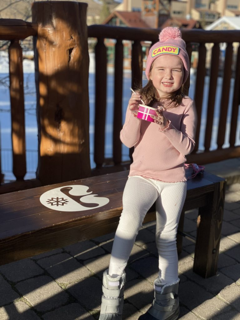 Little girl eating ice cream on the porch of the ski lodge at Copper Mountain.| Guide to Copper Mountain Resort in Colorado