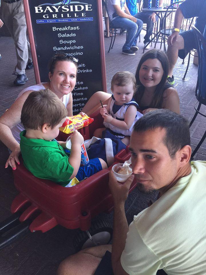 Family eating ice cream at Kemah Boardwalk. | Kemah Boardwalk in Texas