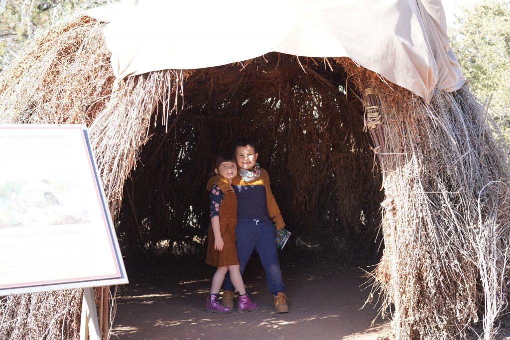 Two kids posing in the Indian cave in Arizona. | Desert Botanical Gardens in Arizona