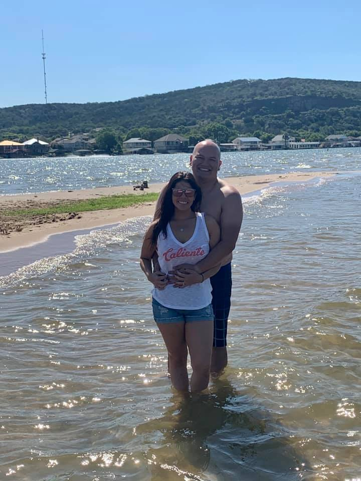 Couple posing on the beach. | Adult Summer Vacation on Lake LBJ