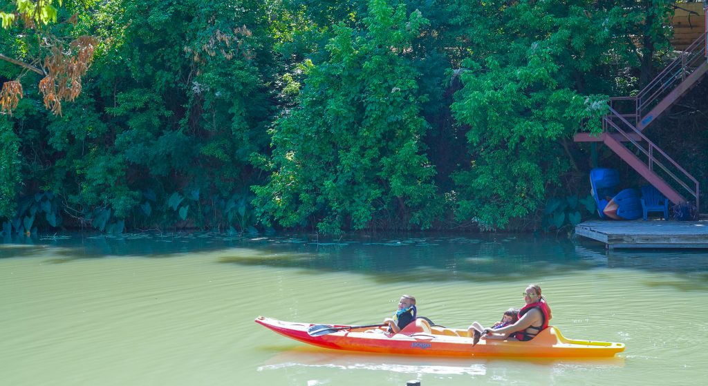 Woman and kids kayaking at Son's Island.| Son's Island in Seguin, Texas