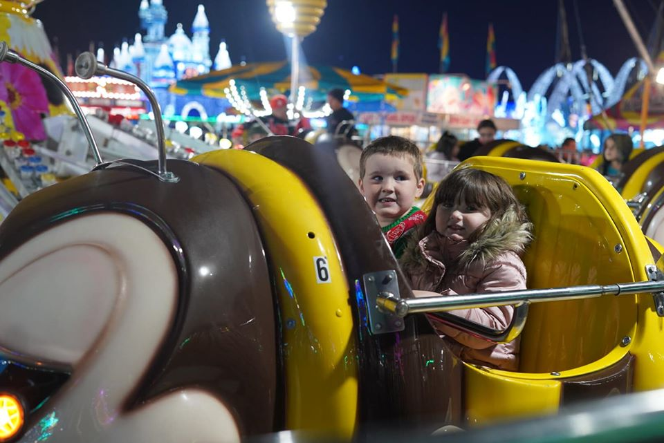 Two kids on the rides at the Winter Lights. | Magical Winter Lights Houston