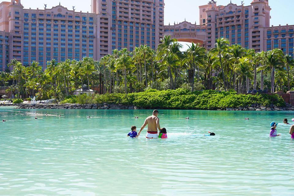 People swimming in the lagoon at the Atlantis resort.   Atlantis, Bahamas