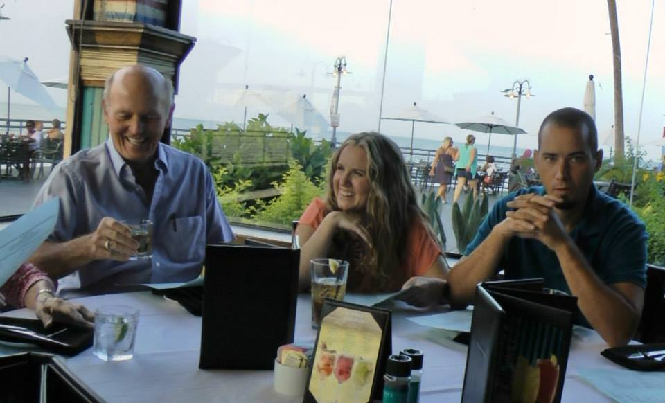 People smiling at the Laundry's Seafood House Restaurant in Kemah. | Kemah Boardwalk in Texas